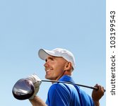 Smiling golfer holding golf club over shoulder - stock photo