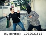 robbery with a firearm secretly ...   Shutterstock . vector #1032031513