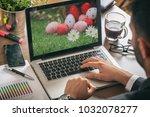 easter eggs on a computer... | Shutterstock . vector #1032078277