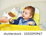 baby boy in the high chair with ... | Shutterstock . vector #1032093967