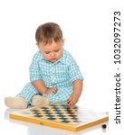 little boy is playing chess on... | Shutterstock . vector #1032097273