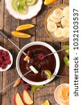 chocolate fondue with fruits | Shutterstock . vector #1032103537