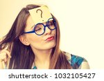thinking woman with big nerdy... | Shutterstock . vector #1032105427