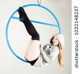 aerial acrobat on a ring. a... | Shutterstock . vector #1032148237