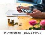 man using calculator and... | Shutterstock . vector #1032154933