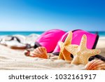 shell decoration on sand and... | Shutterstock . vector #1032161917