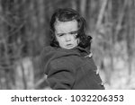 sad young child in nature | Shutterstock . vector #1032206353