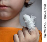 boy with a wound on his finger | Shutterstock . vector #103237103