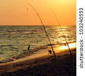 Fishing Rods Set Up On Beach...
