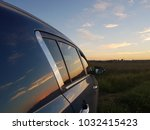 sunset reflection in the car  | Shutterstock . vector #1032415423