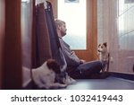 the master loves the dogs and... | Shutterstock . vector #1032419443