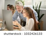 smiling senior mentor... | Shutterstock . vector #1032426133
