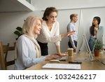 young businesswoman teaching... | Shutterstock . vector #1032426217
