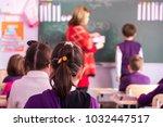 school children are... | Shutterstock . vector #1032447517
