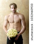 muscular athlete holding... | Shutterstock . vector #1032460933