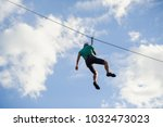 a man descends on a rope  a... | Shutterstock . vector #1032473023
