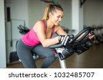 beautiful young woman doing... | Shutterstock . vector #1032485707