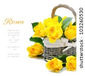 Freshly cut yellow roses in a rustic basket - stock photo