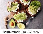 sliced avocado on toast bread...   Shutterstock . vector #1032614047