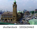 historic harbor in hamburg with ... | Shutterstock . vector #1032624463