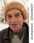 Small photo of Taraclia, Moldova, January 18, 2018. Old man. The philosopher in the street. Tramp.