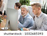 focused senior and young... | Shutterstock . vector #1032685393