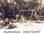 Small photo of Blurred abstract outdoor playground activities at public park in Texas, America. Children play on swing, kids and parents doing activity together background. Vintage tone
