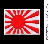 Small photo of Japanese rising sun flag ensign emblem set upon sixteen red rays, Japanese navy cape gloucester, embroidery on isolated black background with saved clipping path.