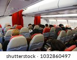 Small photo of Seoul, South Korea - December 17, 2015 : Unidentified travellers in Thai AirAsia X Airbus A330-300 interior