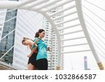 sportswomen stretching after... | Shutterstock . vector #1032866587