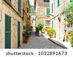 beautiful street in valldemossa ... | Shutterstock . vector #1032891673