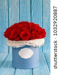 red roses flowers in a blue box ...   Shutterstock . vector #1032920887