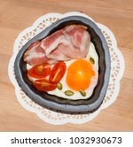 eggs and bacon in a heart... | Shutterstock . vector #1032930673