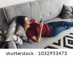 woman lying on the sofa and... | Shutterstock . vector #1032953473