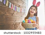 cute little child wearing bunny ... | Shutterstock . vector #1032955483
