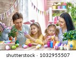 mother  father and daughters... | Shutterstock . vector #1032955507