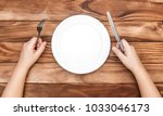 hungry child waiting for meal.... | Shutterstock . vector #1033046173