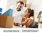 happy adult couple moving out... | Shutterstock . vector #1033053667