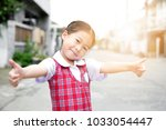 cute asian little girl in... | Shutterstock . vector #1033054447