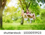two cute little sisters having... | Shutterstock . vector #1033055923