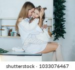 baby girl in white and mother... | Shutterstock . vector #1033076467