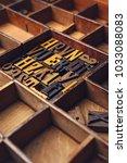wooden letterpress in a... | Shutterstock . vector #1033088083
