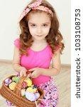 portrait of little girl holding ... | Shutterstock . vector #1033108753