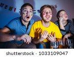 friends at home watching... | Shutterstock . vector #1033109047