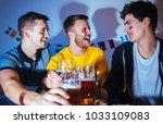 soccer or football fans... | Shutterstock . vector #1033109083