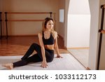 yoga at home. woman stretching...