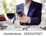 businessman reading red wine... | Shutterstock . vector #1033147027