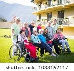 elderly people in park together | Shutterstock . vector #1033162117
