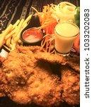 fried chicken steak with french ...   Shutterstock . vector #1033202083