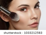 close up of calm female face.... | Shutterstock . vector #1033212583